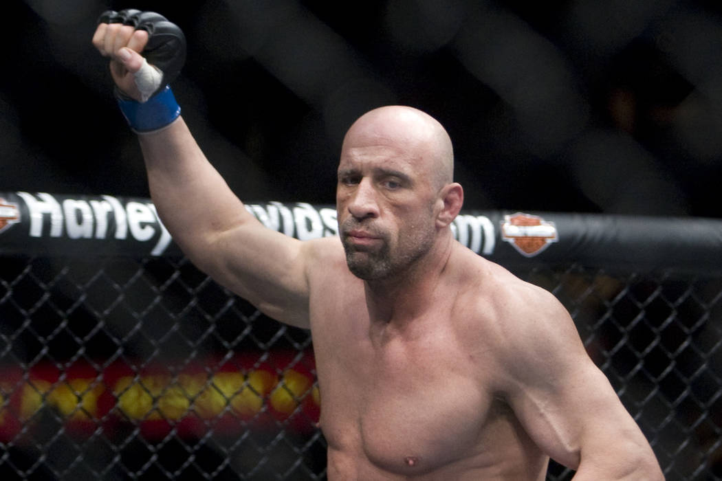 Ultimate Fighting Championship fighter Mark Coleman runs into the octagon prior to taking on his opponent Randy Couture in their light heavyweight bout during UFC 109 at the Mandalay Bay Events Ce ...