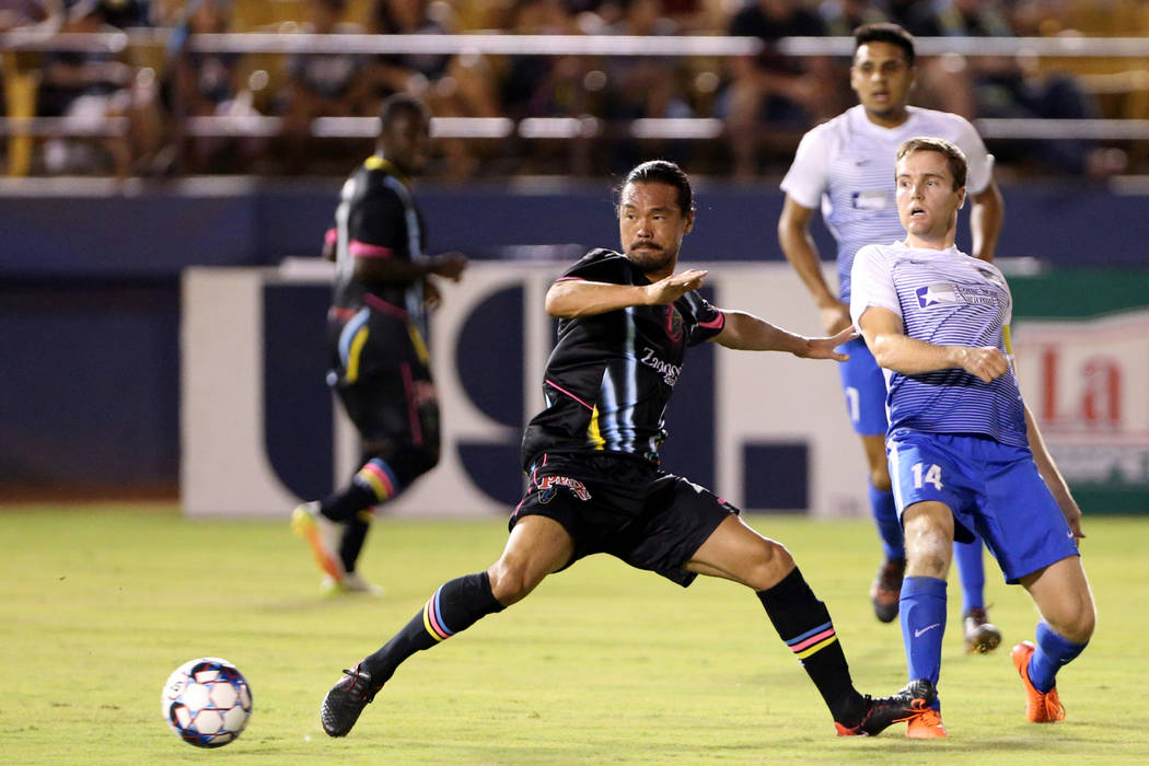 Las Vegas Lights FC midfielder Daigo Kobayashi goes for the ball in front of Rio Grande Valley FC Toros midfielder Todd Wharton (14) in the first half of a soccer game at Cashman Field in Las Vega ...