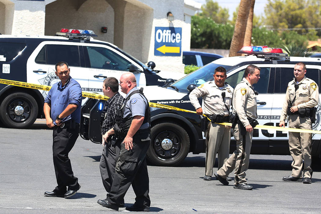 Las Vegas police are at the scene of an officer-involved shooting at Kensington Suites in the 2200 block of West Bonanza Road, Monday, Aug. 6, 2018. (Bizuayehu Tesfaye/Las Vegas Review-Journal) @b ...
