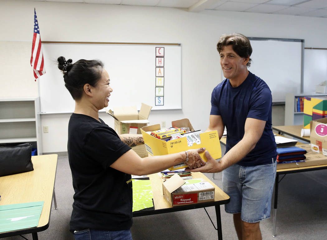 Kristine Reynolds, general manager of Downtown Container Park, left, delivers supplies to specific learning disability teacher, Eric Farrell, on Thursday, Aug. 9, 2018 at Sunrise Acres Elementary ...