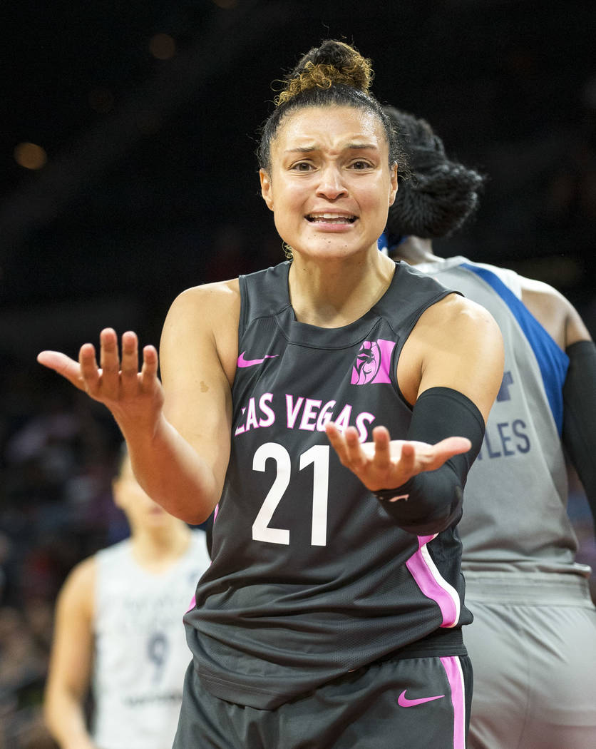 Las Vegas Aces guard Kayla McBride (21) reacts to a play during the first half of a WNBA basketball game against the Minnesota Lynx at the Mandalay Bay Events Center in Las Vegas on Thursday, Aug. ...