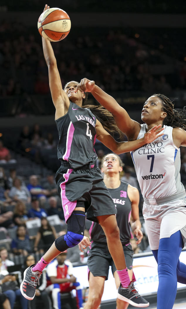 Las Vegas Aces guard Moriah Jefferson (4) attempts a shot against Minnesota Lynx forward Endy Miyem (7) during the second half of a WNBA basketball game at the Mandalay Bay Events Center in Las Ve ...
