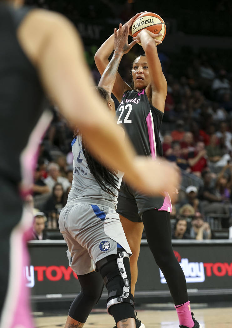 Las Vegas Aces center A'ja Wilson (22) takes a shot over Minnesota Lynx forward Erlana Larkins (2) during the second half of a WNBA basketball game at the Mandalay Bay Events Center in Las Vegas o ...