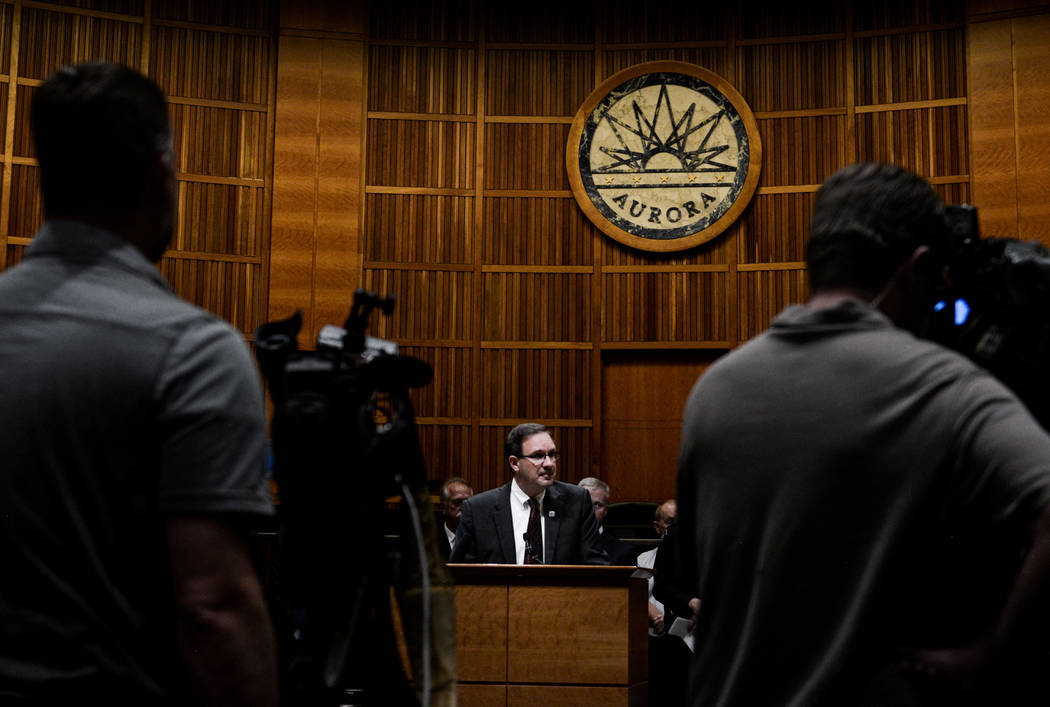 John Camper, director of the Colorado Bureau of Investigation, gives updates during a news conference at the Aurora Municipal Center on Friday, Aug. 10, 2018, regarding two 1984 homicides. Officer ...