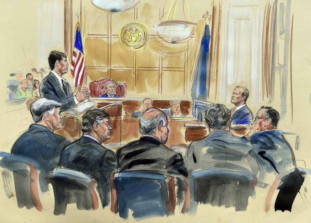 This courtroom sketch depicts Rick Gates, right, answering questions by prosecutor Greg Andres as he testifies in the trial of Paul Manafort, seated second from left, at the Alexandria Federal Cou ...