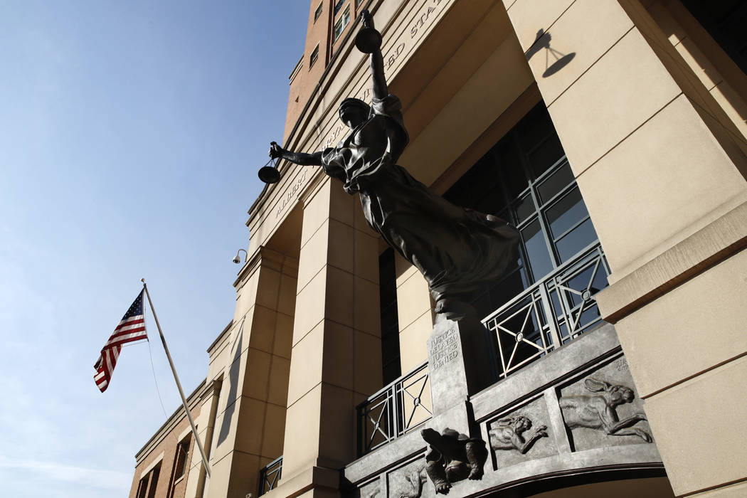 Federal court is seen as the trial of former Trump campaign chairman Paul Manafort continues, in Alexandria, Va., Thursday, Aug. 9, 2018. (AP Photo/Jacquelyn Martin)