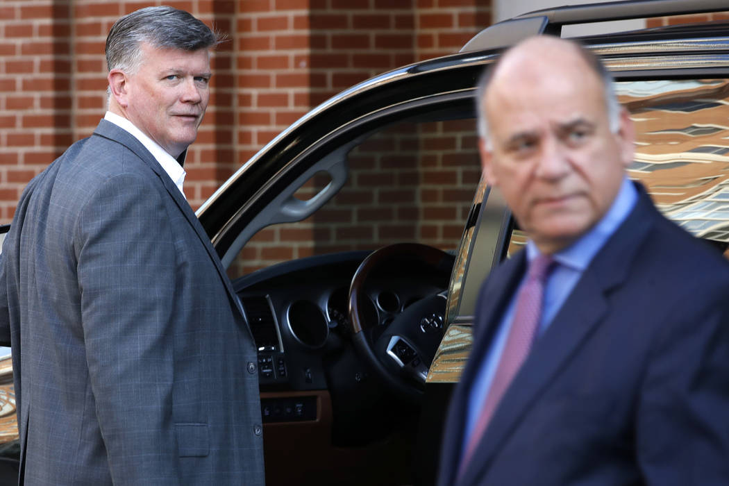 The defense team for Paul Manafort, including Kevin Downing, left, and Thomas Zehnle, right, arrive to attend federal court as the trial of the former Trump campaign chairman continues, in Alexand ...