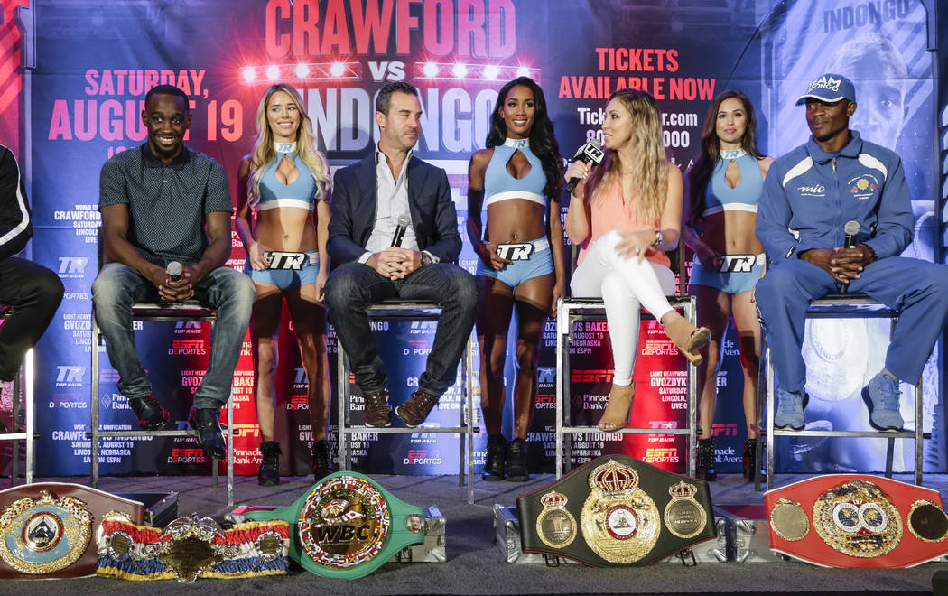 """Undefeated 140 pound world champions Terence """"Bud"""" Crawford (WBO and WBC champion), left, and Julius Indongo (IBF and WBA champion), right, participate in a news conference with their ch ..."""