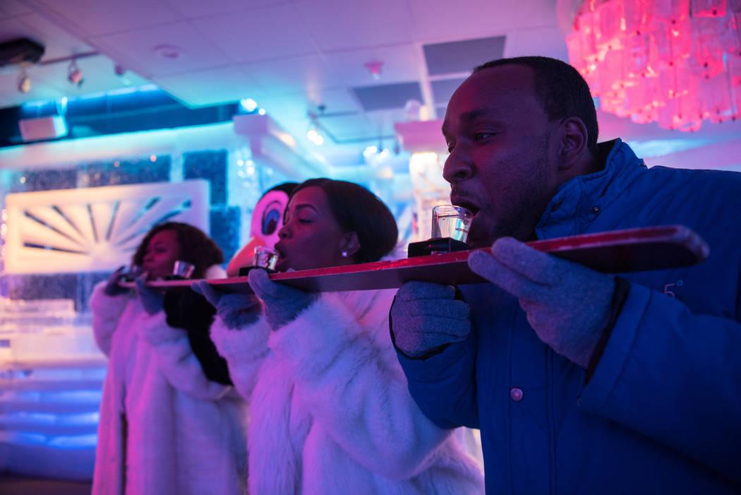 "Kendra Gilbert, Krishona Gilbert, and Kevin Gilbert attempt the ""Shot Ski"" at the Minus5 Ice Bar at Mandalay Bay Resort and Casino on Thursday, June 15, 2017, in Las Vegas. Morgan Liebe ..."
