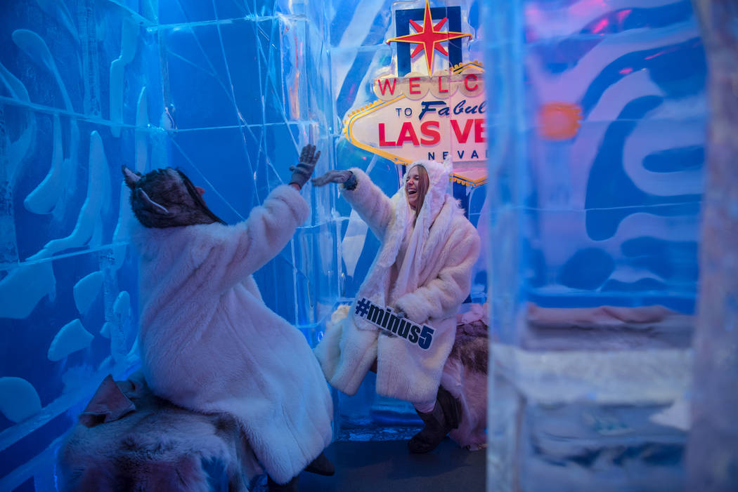 Minus5 Ice Experience employees Allison Keepman and Brooke Rodriguez enjoy the VIP lounge at Minus5 Ice Bar at Mandalay Bay Resort and Casino on Thursday, June 15, 2017, in Las Vegas. The temperat ...