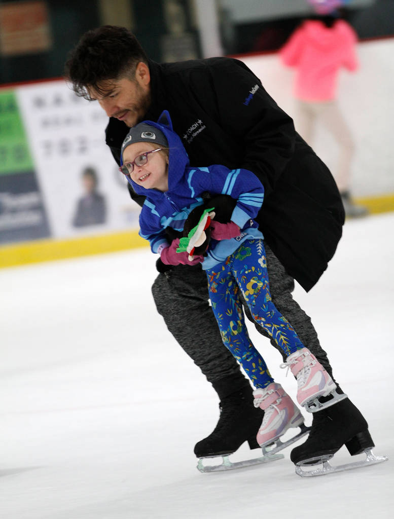 Layla Dehoyos, 5, of Las Vegas skates with her coach Diego Hernandez after their class at Las Vegas Ice Center in Las Vegas, Wednesday, July 18, 2018. Chitose Suzuki Las Vegas Review-Journal @chit ...