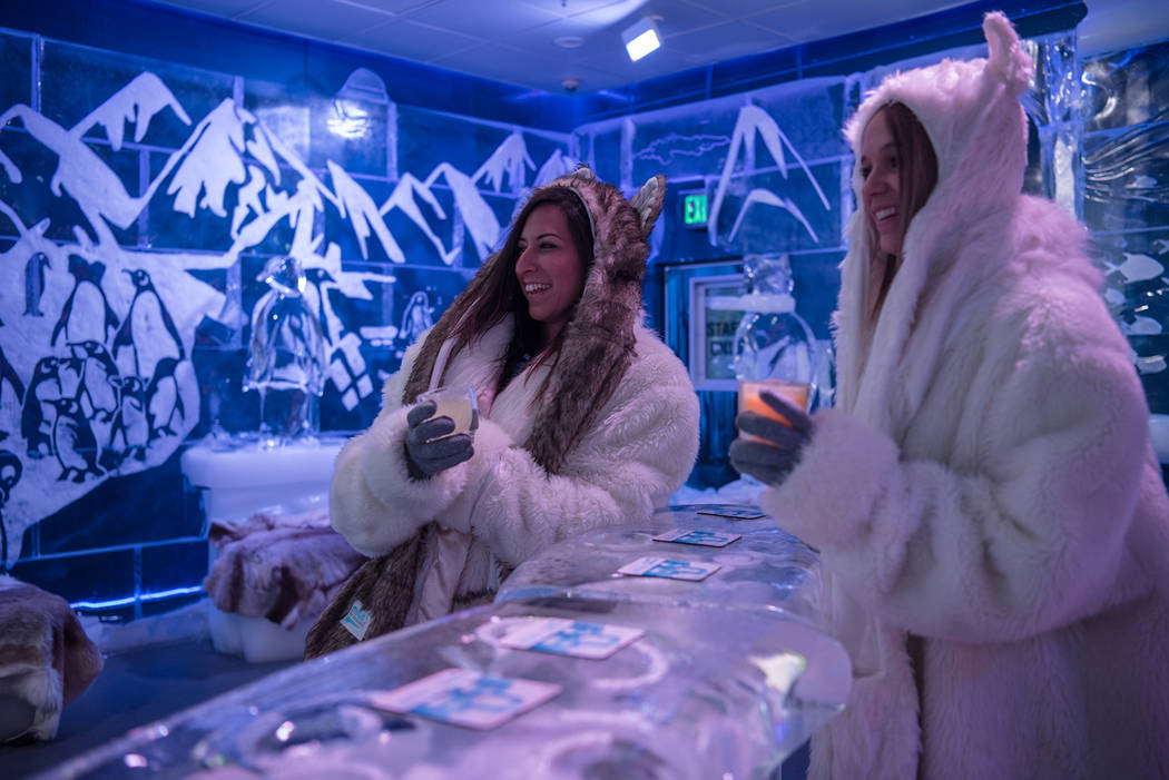 Minus5 Ice Experience employees Allison Keepman and Brooke Rodriguez enjoy Happy Hour at Minus5 Ice Bar at Mandalay Bay Resort and Casino on Thursday, June 15, 2017, in Las Vegas. The temperature ...