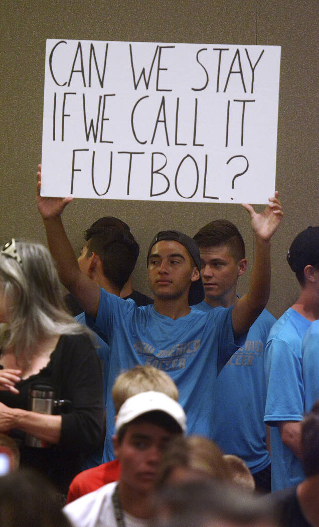 In this July 19, 2018 file photo Cleveland High School soccer player Mariano Barreras, of Rio Rancho, N.M., holds up a sign supporting the University of New Mexico men's soccer program, during the ...