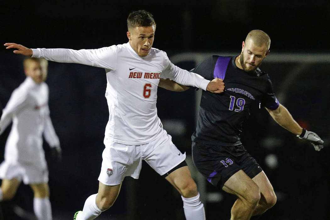 In this Dec. 7, 2013, file photo, New Mexico midfielder Ben McKendry, left, battles for the ball with Washington's Michael Harris the NCAA men's soccer tournament at Husky Soccer Stadium in Seattl ...