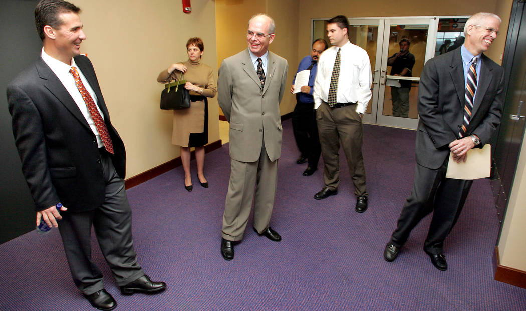 This Dec. 7, 2004, file photo shows Florida head football coach Urban Meyer, far left, sharing a laugh with President Bernie Machen, center, and Athletic Director Jeremy Foley, far right, prior to ...