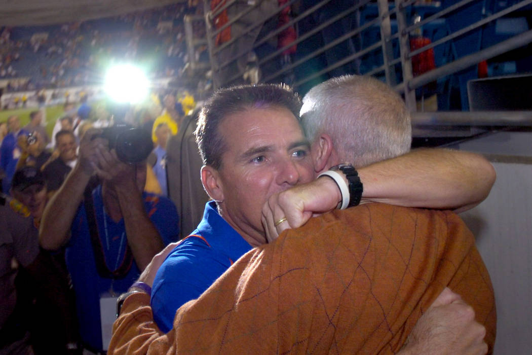 University of Florida head coach Urban Meyer, left, hugs athletic director Jeremy Foley after an NCAA college football game against Georgia, Saturday, Oct. 30, 2010, in Jacksonville, Fla,. Florida ...