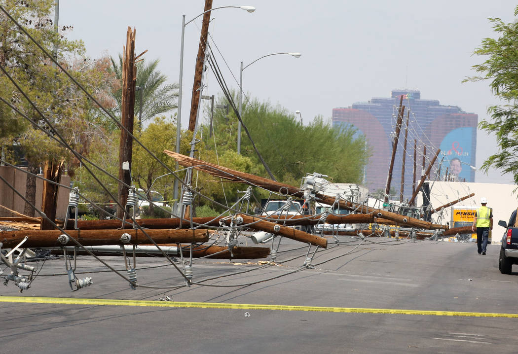 Power lines at Sunset Road and Polaris Avenue are down, caused by forklift on Friday, Aug. 10, 2018, in Las Vegas. Bizuayehu Tesfaye/Las Vegas Review-Journal @bizutesfaye