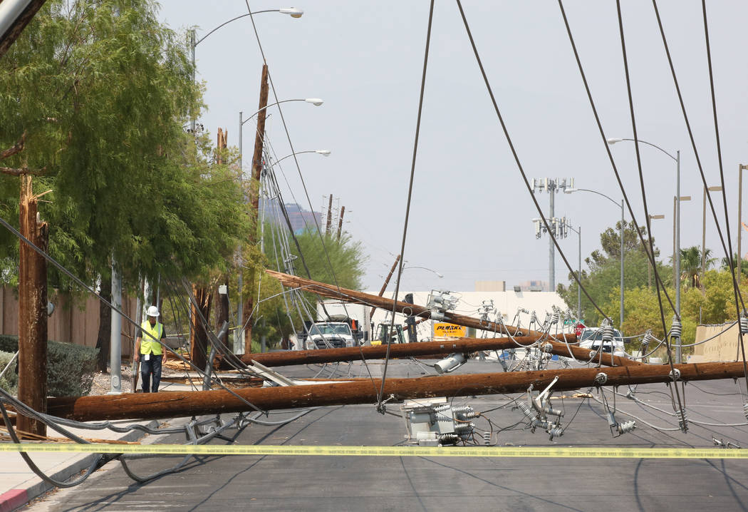 Downed power lines at Sunset Road and Polaris Avenue on Friday, Aug. 10, 2018, in Las Vegas. Forklift knocks down 13 power poles. Bizuayehu Tesfaye/Las Vegas Review-Journal @bizutesfaye