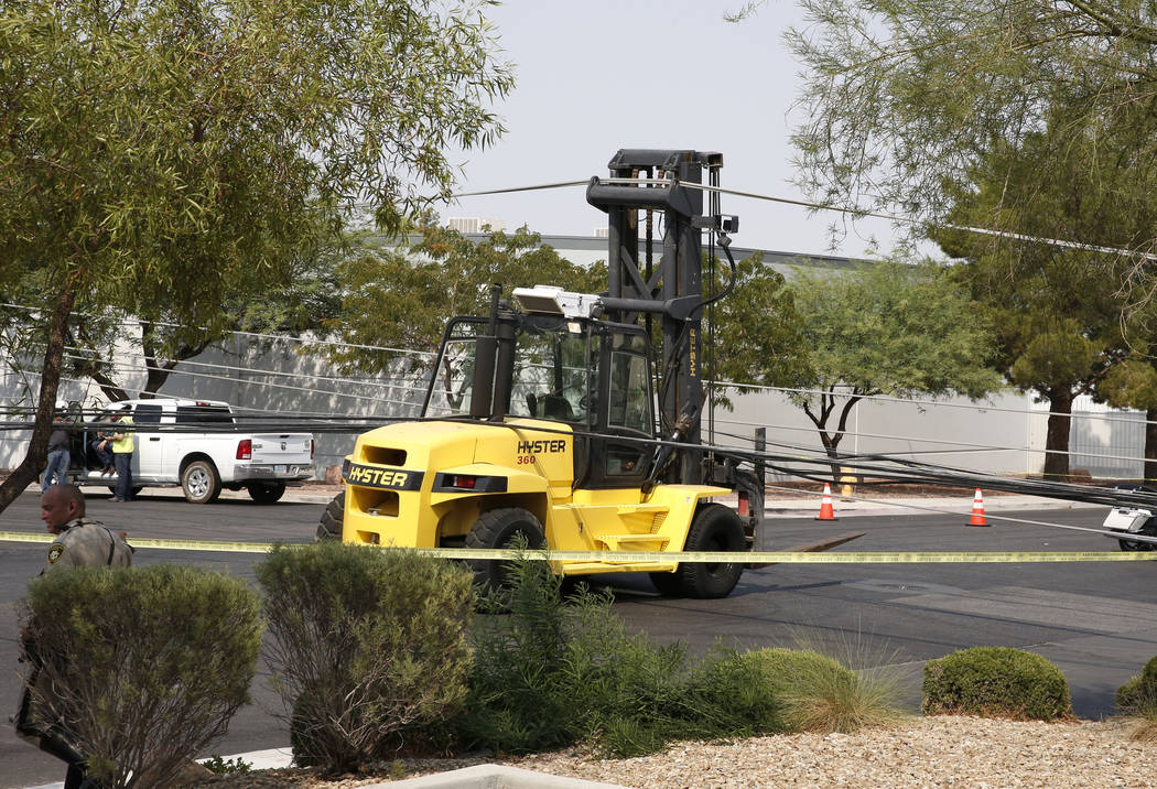 A forklift is seen after knocking down power lines at Sunset Road and Polaris Avenue on Friday, Aug. 10, 2018, in Las Vegas. Forklift knocks down 13 power poles. Bizuayehu Tesfaye/Las Vegas Review ...