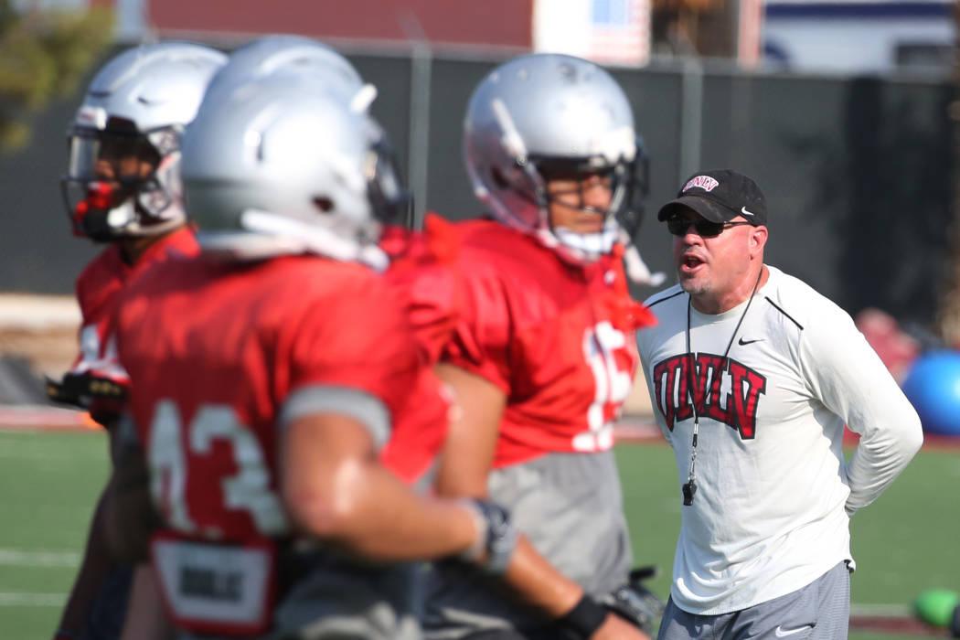 UNLV Rebels head coach Tony Sanchez yells to his players during team practice on Thursday, Aug. 9, 2018, in Las Vegas. Bizuayehu Tesfaye/Las Vegas Review-Journal @bizutesfaye