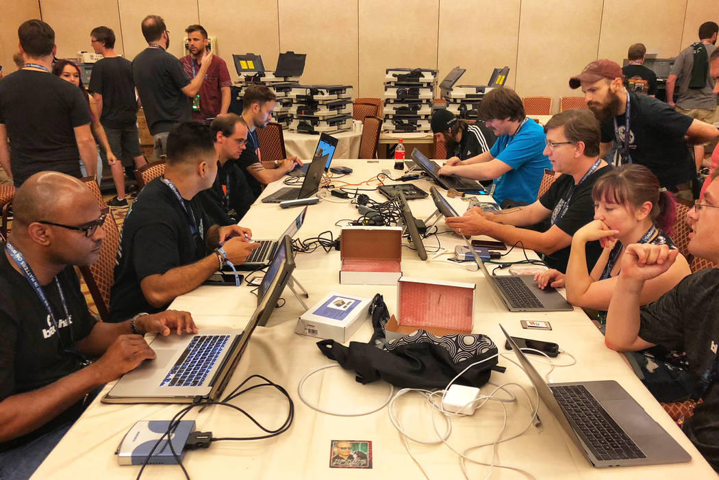 Cyber security enthusiasts and professionals trying to hack U.S. election equipment at DefCon conference at Caesars Palace on Friday. (Todd Prince/Las Vegas Review-Journal)