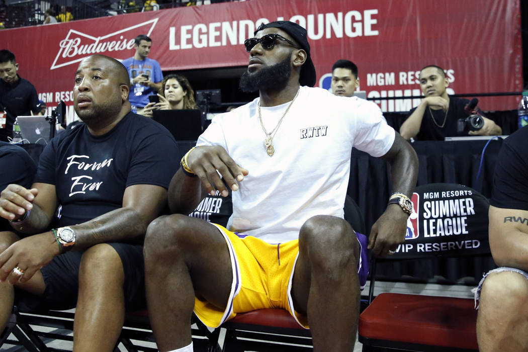 The Los Angeles Lakers LeBron James watches an NBA Summer League basketball game between the Lakers and the Detroit Pistons at the Thomas and Mack Center on Sunday, July 15, 2018, in Las Vegas. Bi ...