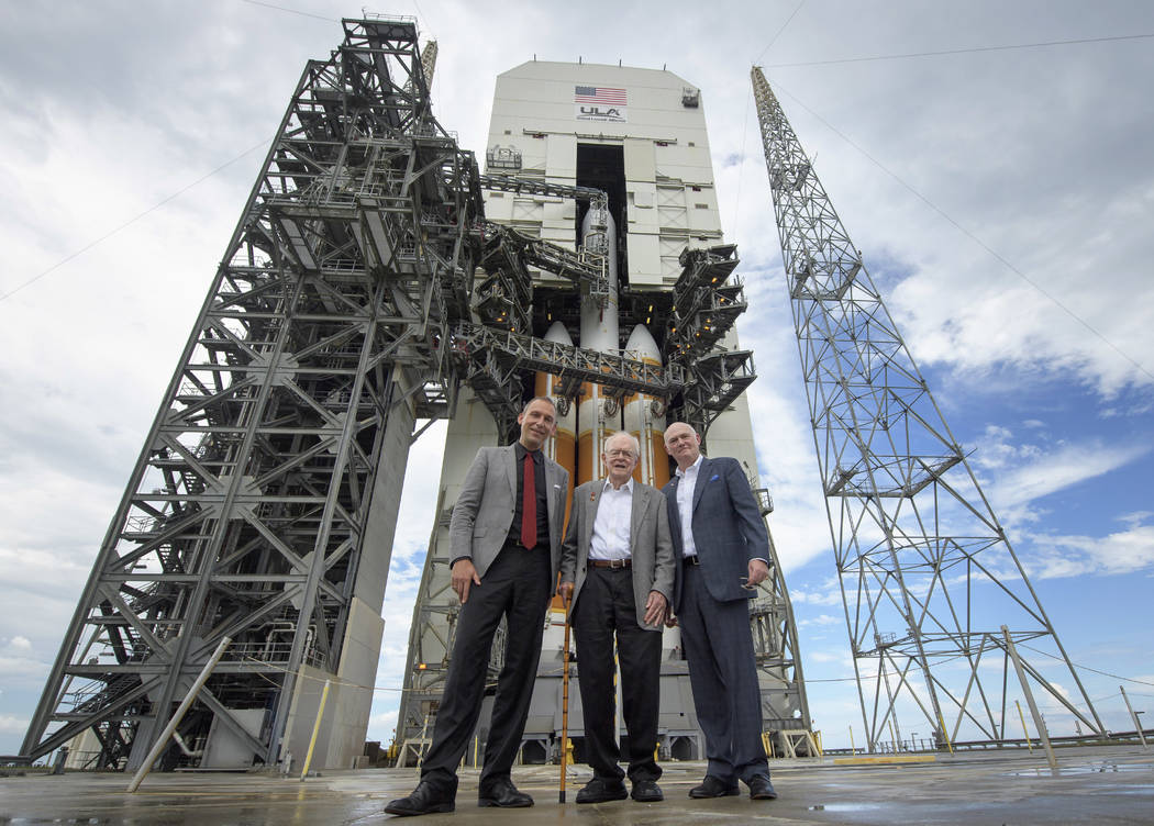 Astrophysicist Eugene Parker, center, stands with NASA Associate Administrator for the Science Mission Directorate Thomas Zurbuchen, left, and United Launch Alliance President and Chief Executive ...