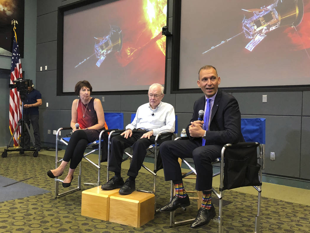 Astrophysicist Eugene Parker sits between Johns Hopkins University project scientist Nicola Fox, left, and NASA's science mission chief Thomas Zurbuchen, during a news conference about the Parke ...
