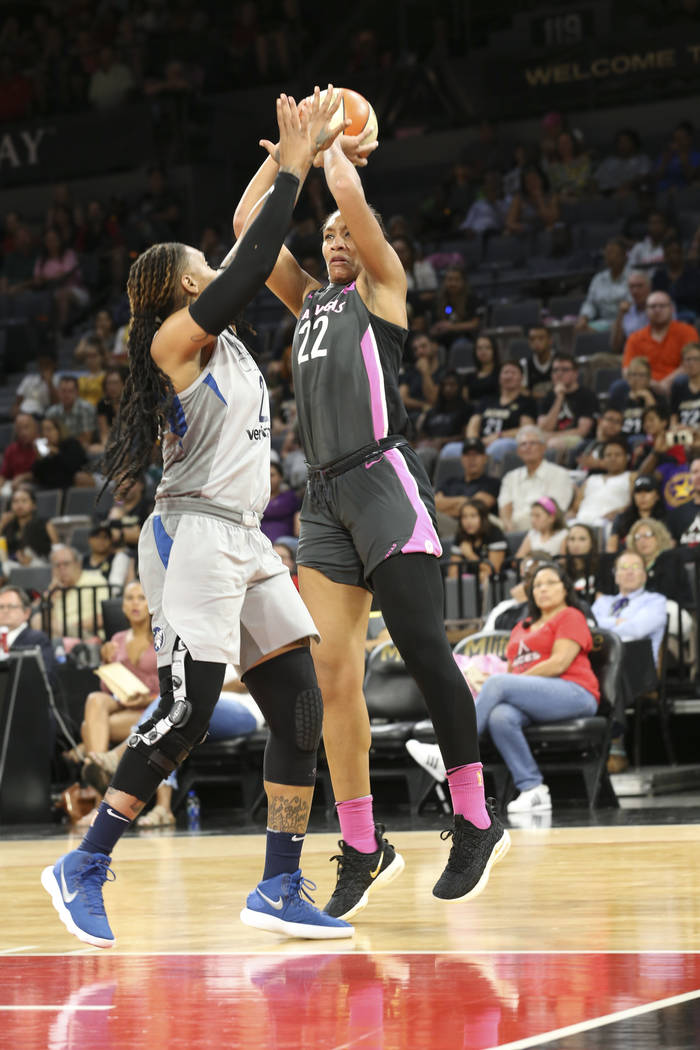 Las Vegas Aces center A'ja Wilson (22) shoots over Minnesota Lynx forward Erlana Larkins (2) during the first half of a WNBA basketball game at the Mandalay Bay Events Center in Las Vegas on Thurs ...