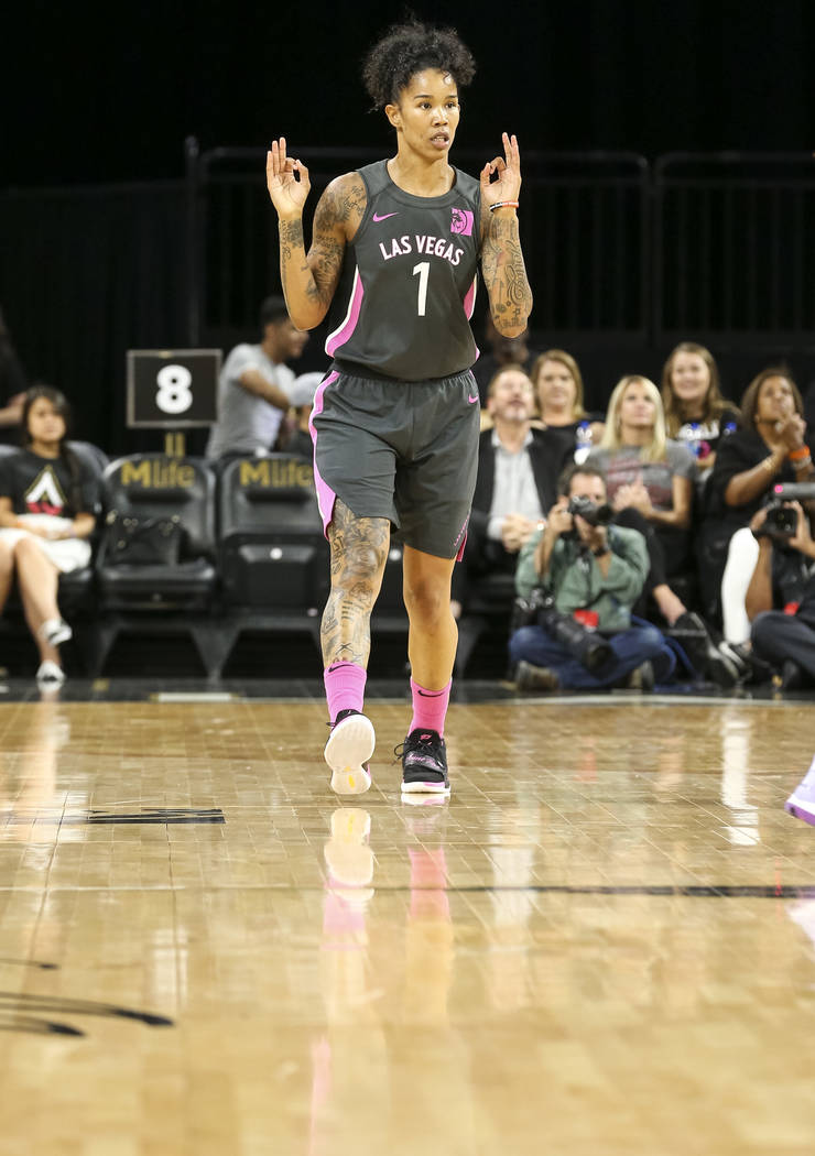 Las Vegas Aces guard Kayla McBride (21) gestures after making a three point basket against the Minnesota Lynx during the first half of a WNBA basketball game at the Mandalay Bay Events Center in L ...