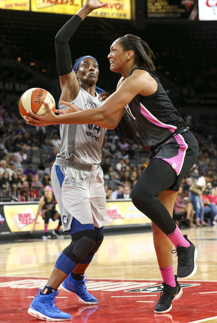 Las Vegas Aces center A'ja Wilson (22) goes up for a shot against Minnesota Lynx center Sylvia Fowles (34) during the second half of a WNBA basketball game at the Mandalay Bay Events Center in Las ...