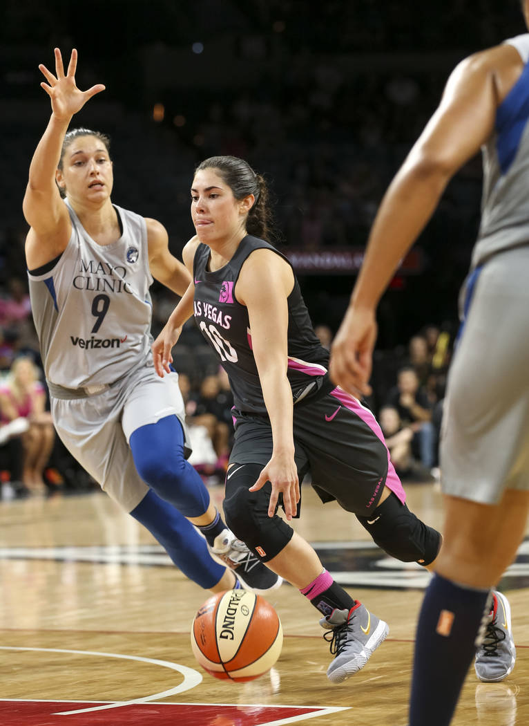 Las Vegas Aces guard Kelsey Plum (10) dribbles the ball as Minnesota Lynx forward Cecilia Zandalasini (9) defends during the second half of a WNBA basketball game at the Mandalay Bay Events Center ...