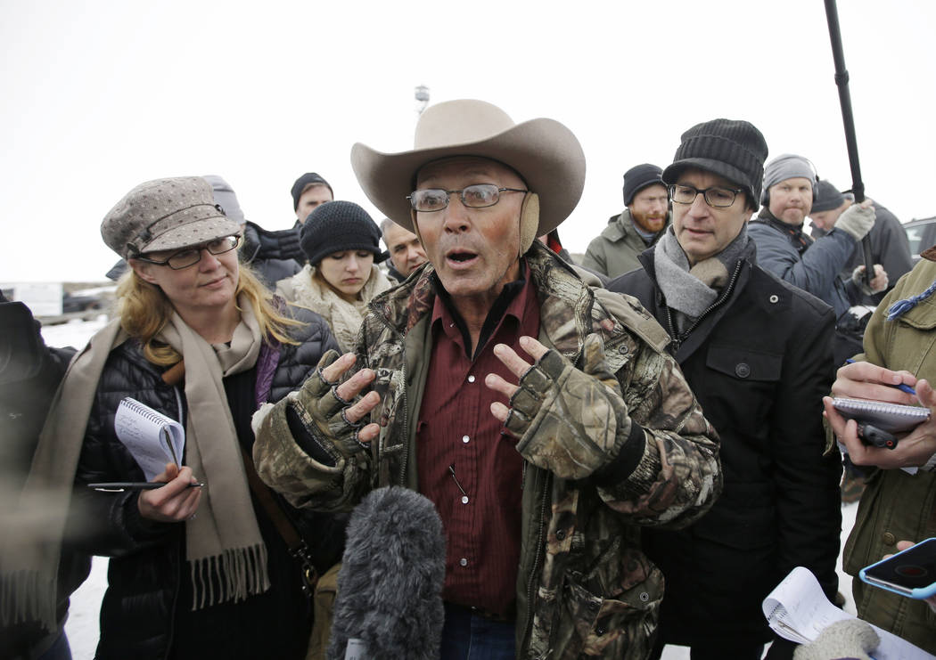 "In this Jan. 5, 2016 file photo, Robert ""LaVoy"" Finicum, center, a rancher from Arizona, talks to reporters at the Malheur National Wildlife Refuge near Burns, Ore. (AP Photo/Rick Bowmer, File)"