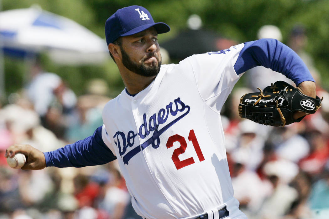 In this Friday, March 14, 2008, file photo, Los Angeles Dodgers starting pitcher Esteban Loaiza pitches to St. Louis Cardinals' Cesar Izturis during the first inning of a spring training baseball ...
