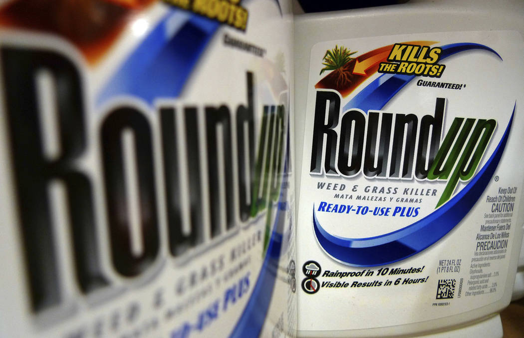 Bottles of Roundup herbicide, a product of Monsanto, are displayed on a store shelf in St. Louis. (AP Photo/Jeff Roberson)