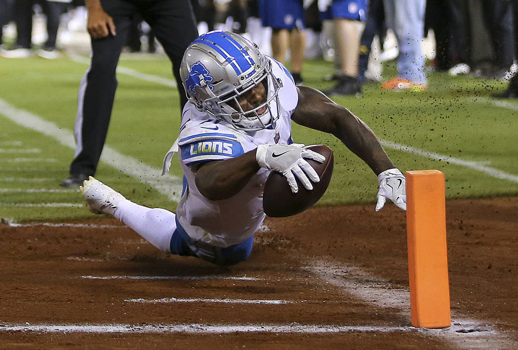 Detroit Lions running back Ameer Abdullah reaches for the pylon but does not score during the first half against the Oakland Raiders in an NFL football preseason game in Oakland, Calif., Friday, A ...