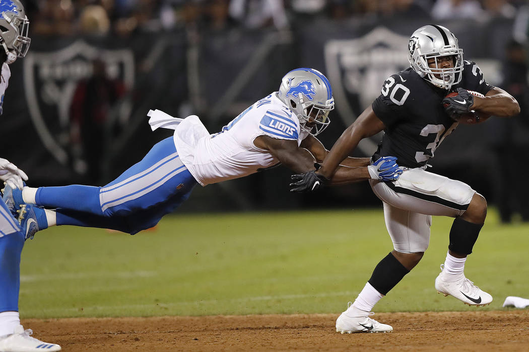 Oakland Raiders running back Jalen Richard (30) carries against Detroit Lions defensive back Rolan Milligan during the first half of an NFL preseason football game in Oakland, Calif., Friday, Aug. ...