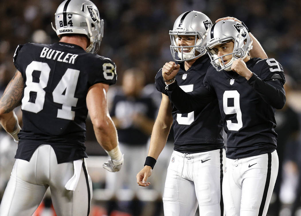 Oakland Raiders kicker Eddy Pineiro (9) celebrates with Paul Butler (84) and Johnny Townsend after kicking a field goal against the Detroit Lions during the first half of an NFL preseason football ...
