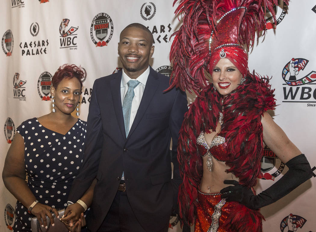 Aaron Pryor Jr., middle, with wife Kristen, left, and showgirl Amanda Nowak on the red carpet before the start of the Nevada Boxing Hall of Fame gala on Saturday, Aug. 18, 2018, at Caesars Palace, ...