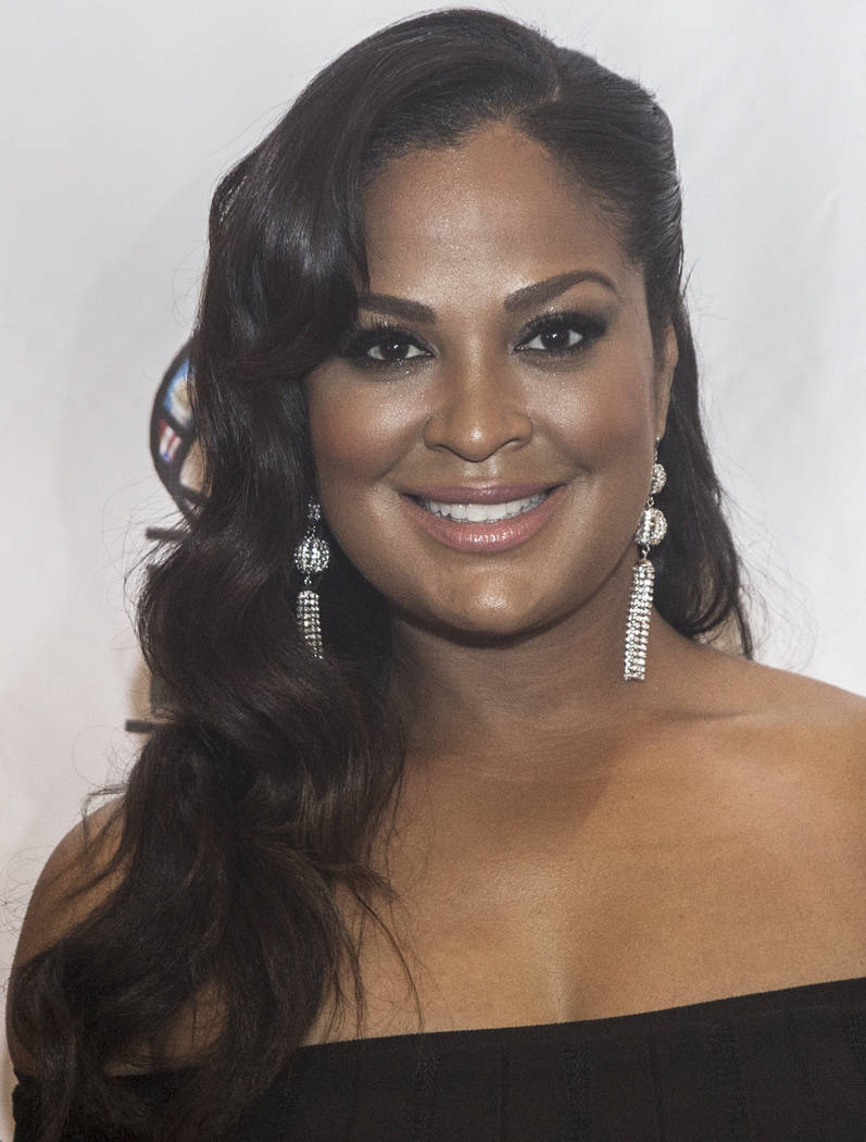Laila Ali, daughter of boxing great Muhammad Ali, takes photos on the red carpet before the start of the Nevada Boxing Hall of Fame gala on Saturday, Aug. 18, 2018, at Caesars Palace, in Las Vegas ...