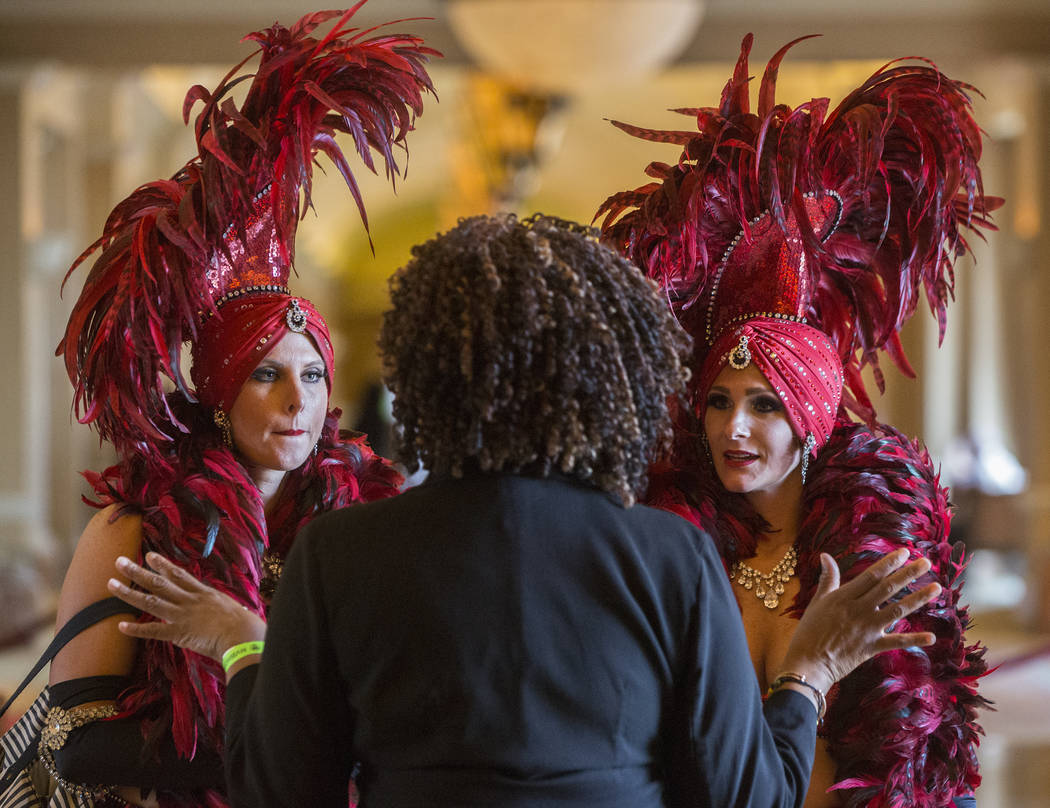 Showgirls Amanda Nowak, left, and Stephanie Hibbert speak with concierge specialist Jackie B before the start of the red carpet at the Nevada Boxing Hall of Fame gala on Saturday, Aug. 18, 2018, ...