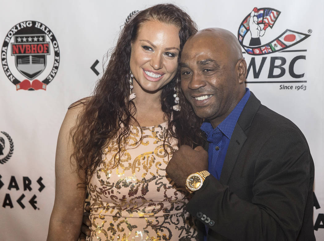 Joel Casamayor, right, and wife Adriana take photos on the red carpet before the start of the Nevada Boxing Hall of Fame gala on Saturday, Aug. 18, 2018, at Caesars Palace, in Las Vegas. Benjamin ...