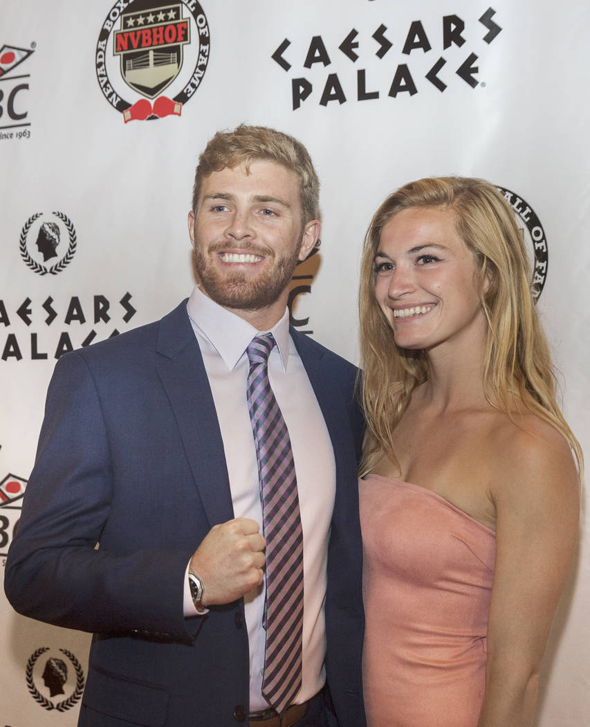 Zack Smith, left, Nevada Boxing Hall of Fame state Amateur Fighter of the Year, and Danielle Pelz, take photos on red carpet before the start of the Nevada Boxing Hall of Fame gala on Saturday, Au ...