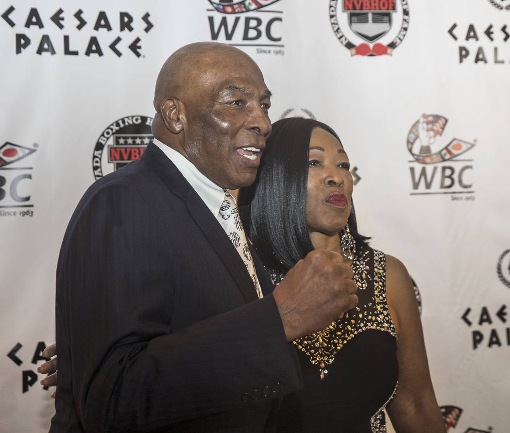 Former boxer Ernie Shavers, left, takes photos on the red carpet before the start of the Nevada Boxing Hall of Fame gala on Saturday, Aug. 18, 2018, at Caesars Palace, in Las Vegas. Benjamin Hager ...