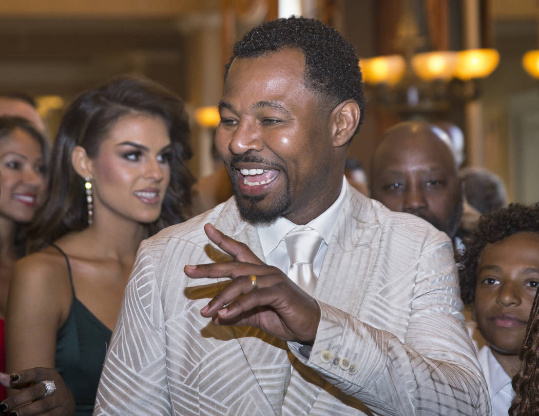 Shane Mosley, a former three-division boxing world champion, waves to friends during the red carpet before the start of the Nevada Boxing Hall of Fame gala on Saturday, Aug. 18, 2018, at Caesars P ...