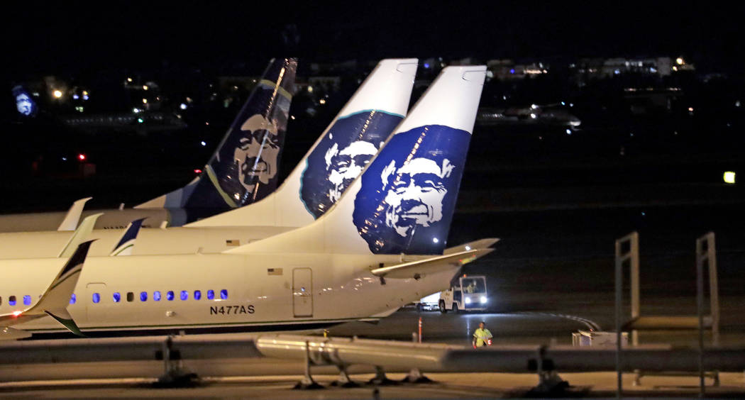 Alaska Airlines planes sit on the tarmac at Sea-Tac International Airport Friday evening, Aug. 10, 2018, in SeaTac, Wash. (AP Photo/Elaine Thompson)