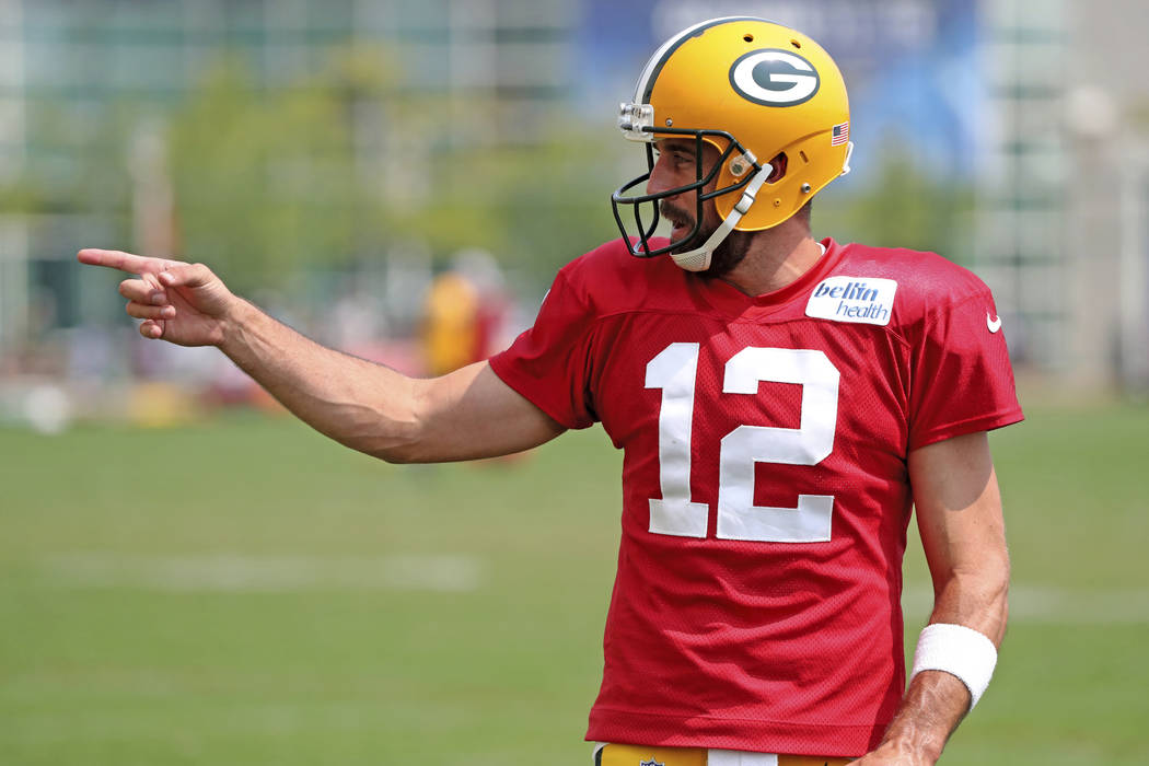 Green Bay Packers quarterback Aaron Rodgers (12) kids with a fan during NFL football training camp Monday, Aug. 13, 2018 at Ray Nitschke Field in Ashwaubenon, Wis. (Jim Matthews/The Post-Crescent ...