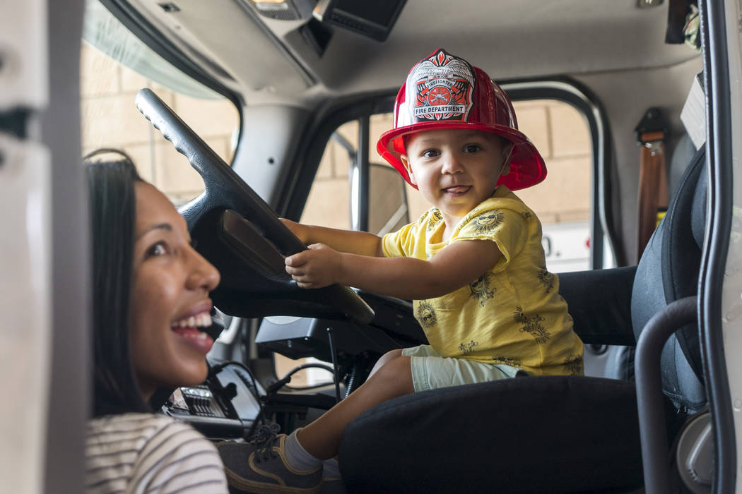 Phenix Teixeira, 2, and his mother, Jade Teixeira check out a rescue vehicle at Fire Station 92 in Henderson, Saturday, Aug. 11, 2018. City of Henderson Fire Department holds an open house at a di ...
