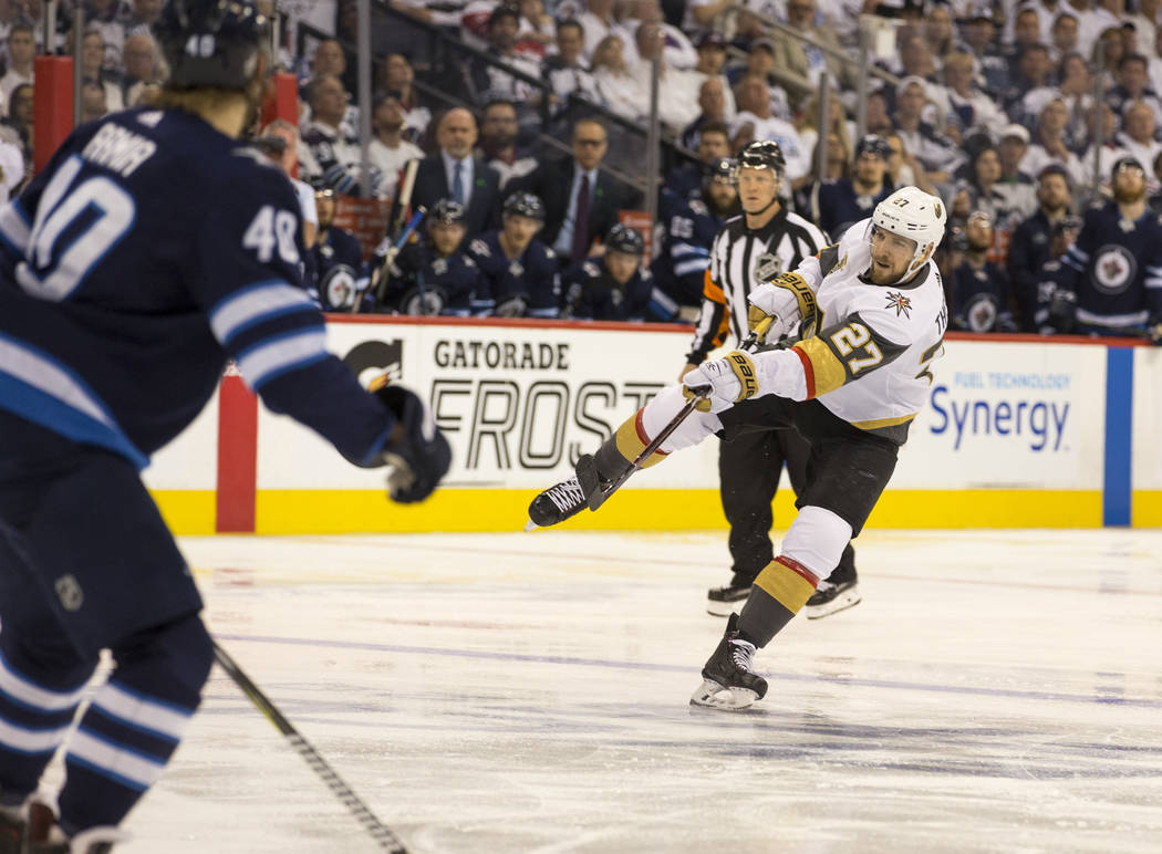 Vegas Golden Knights defenseman Shea Theodore (27) takes a shot on goal against the Winnipeg Jets during the second period in Game 2 of an NHL hockey third round playoff series at the Bell MTS Pla ...