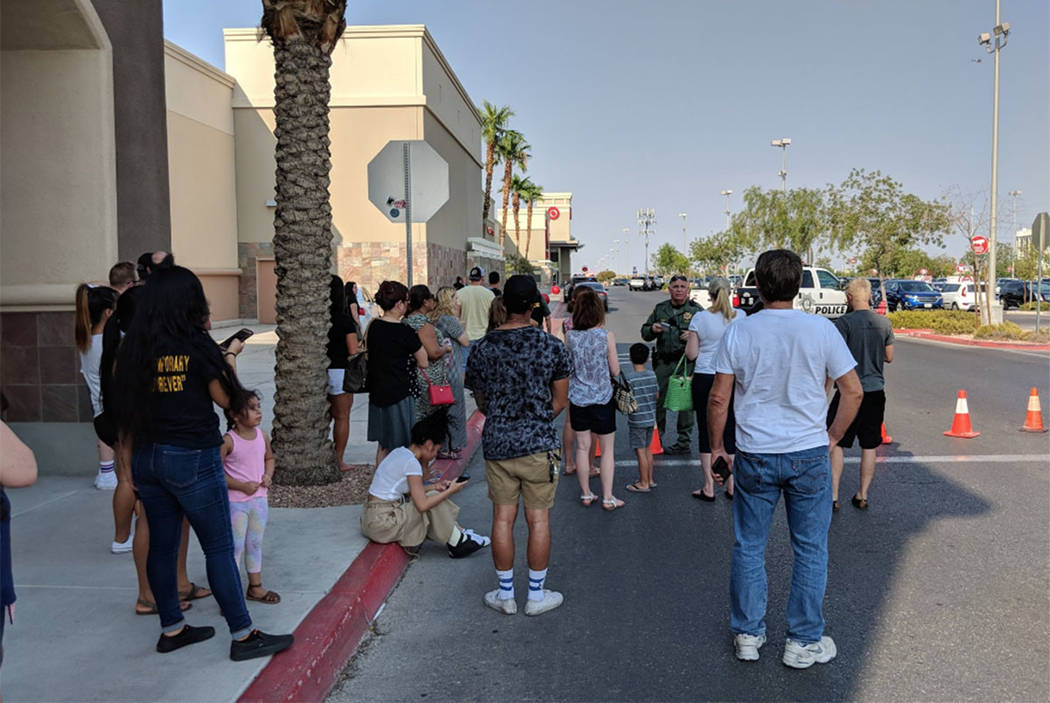 Shoppers wait outside at Blue Diamond Crossing shopping center on Blue Diamond Road in Las Vegas on Saturday, Aug. 11, 2018. (Richard Brian/Las Vegas Review-Journal)